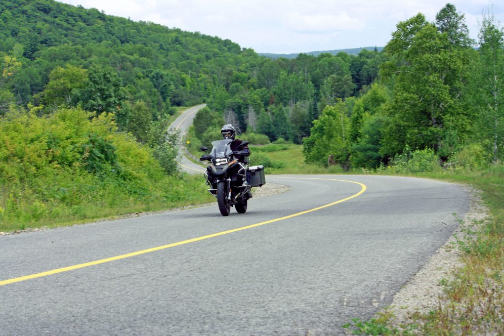 Man on motorcycle on twisty road