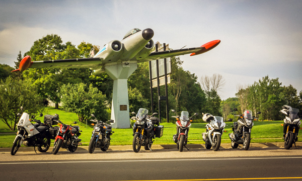 Motorcycles in front of the CF-100 Canuck war monument