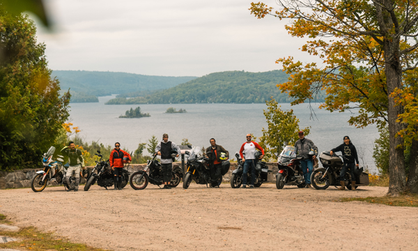 Motorcycle riders in front of Kamaniskeg Lake