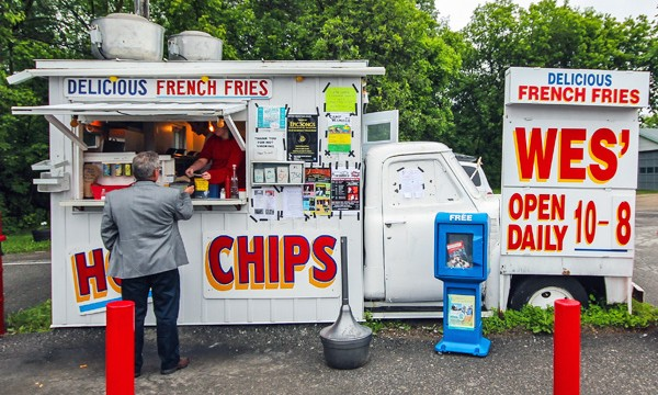 Man purchasing food at a chip truck